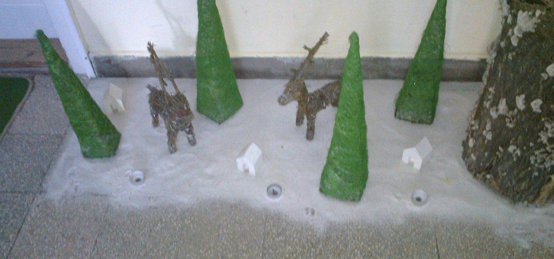 Szarvasok és havas táj karácsonykor